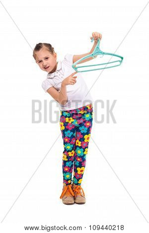 Smiling Little Girl Holding A Shirt In Hanger. Cut Out