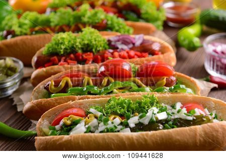 Hot dogs and vegetables on craft paper closeup