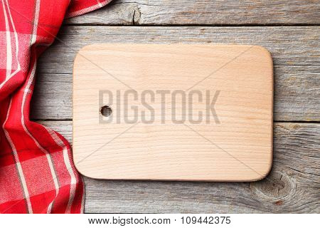 Empty Wooden Table With Cutting Board And Napkin On Grey Background