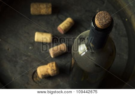 Wine bottle with barrel and corks
