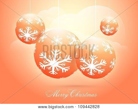 Snowflakes decorated hanging Xmas Balls on glossy cloudy background for Merry Christmas celebration.