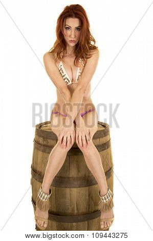 Woman In A Bikini Sitting On A Barrel Knees Together