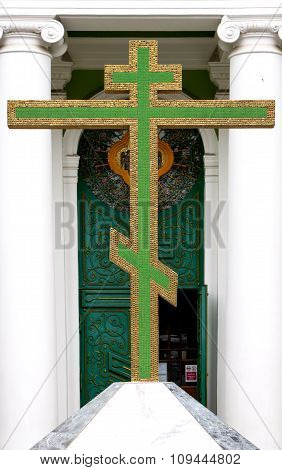 Big Green Christian Golden Cross At Entrance To Temple Filtered