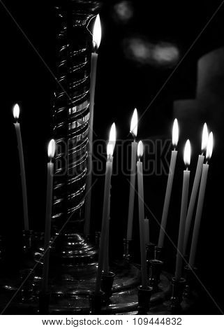 Burning Candles On Gold Candlestick In The Church Isolated On Black Background Black And White