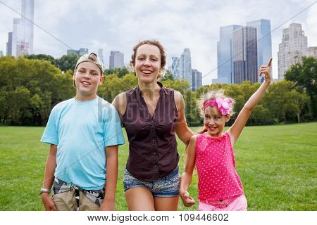 mother with daughter and son in the park