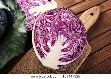 Red cabbage on wooden table