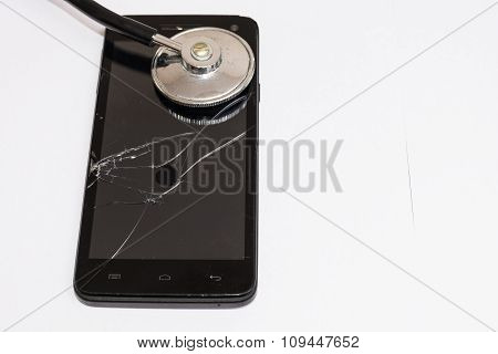 Black Smartphone With Broken Glass And Stethoscope.