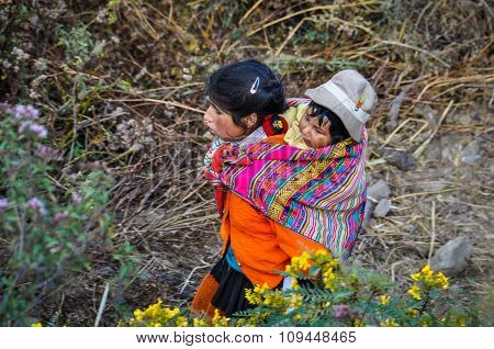 Quechua Mother With Child In A Village In The Andes, Ollantaytambo, Peru