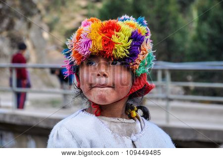 Quechua Girl Watching In A Village In The Andes, Ollantaytambo, Peru