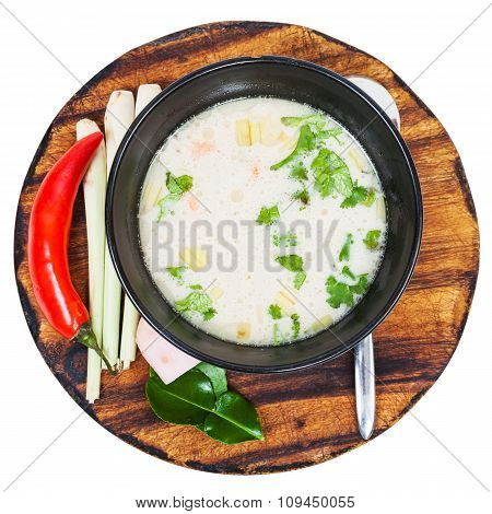 Above View Of Thai Soup Tom Yam In Bowl On Board