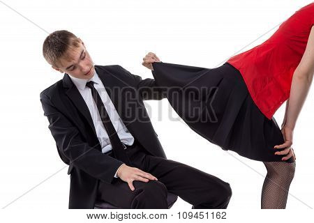 Woman and man looking under skirt