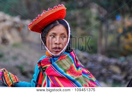 Quechua Woman Looking Back In A Village In The Andes, Ollantaytambo, Peru