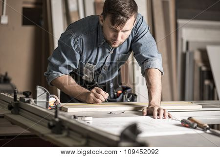 Woodworker Working On Professional Workbench