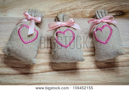 Cloth bags with pink hearts.