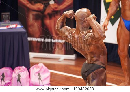Male Bodybuilder Shows His Best Back Double Biceps Pose