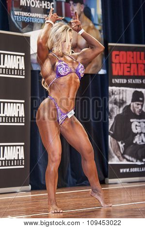 Female Bodybuilder In Front Double Biceps Pose And Pink Bikini