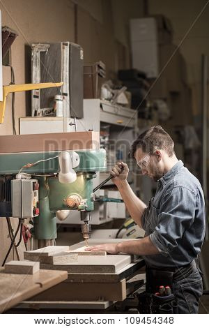 Carpenter In Professionally Equiped Workshop