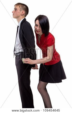 Happy woman stealing money from a man