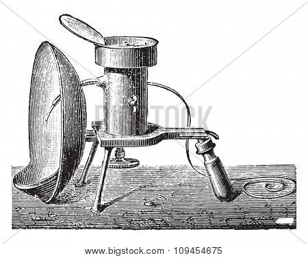 Reflector lamp for burning magnesium, vintage engraved illustration. Industrial encyclopedia E.-O. Lami - 1875.