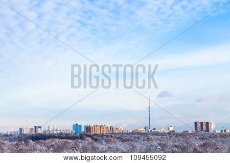 Sky With White Clouds Over Houses And Tv Tower