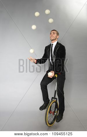 Smiling Man Juggles Balls