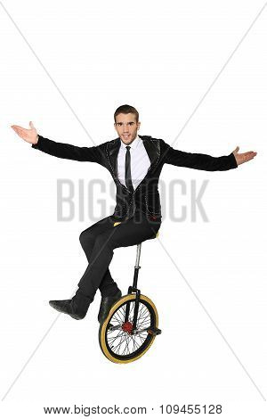 Smiling Man Sitting On A Unicycle. Isolate