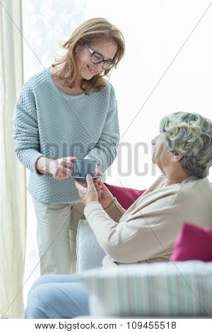 Carer Helping Elder Woman