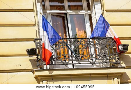 French Flags In The Window Of A Parisian Building