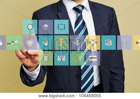Hand of business man pressing compass icon on a toolbar on a touchscreen