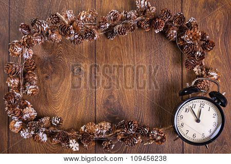 Christmas chain frame with clock on wooden floor