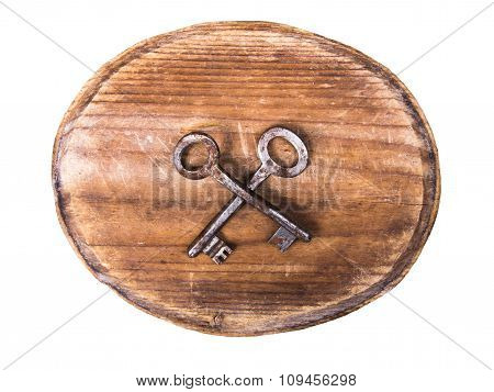 oval wooden signboard and rusty keys