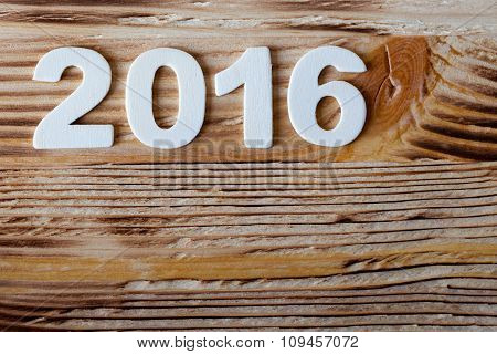 New year postcard frame. date wood texture number on wooden pattern background.