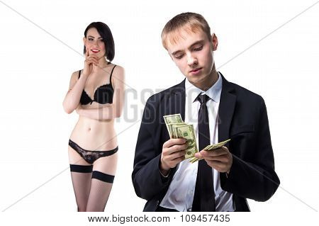 Man counting money and woman in underwear