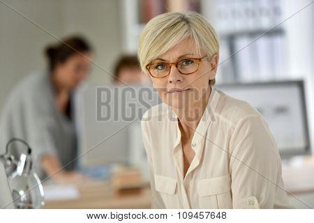 Senior businesswoman standing in office