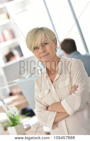 Senior businesswoman standing in office