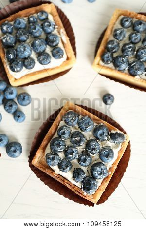 Gourmet fresh blueberry tarts on table