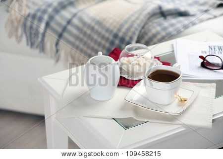 Cup of tea on table in living room