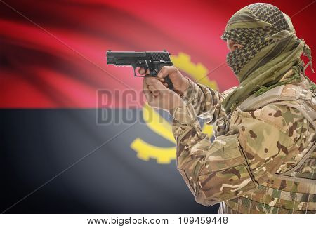 Male In Muslim Keffiyeh With Gun In Hand And National Flag On Background - Angola