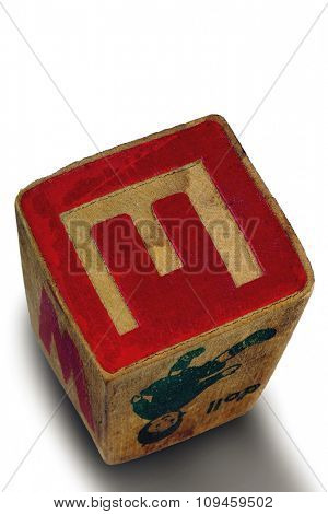 old letter cube showing