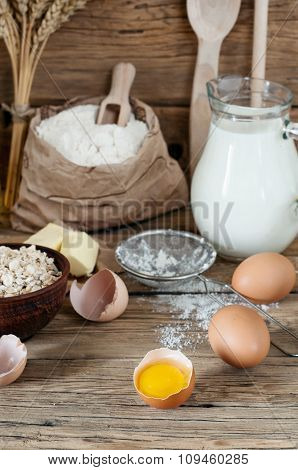 Half Raw Eggs With Ingredients For Making Bakery Products