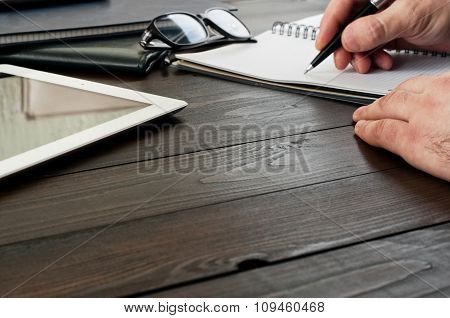 Male Hands Writing In A Notebook
