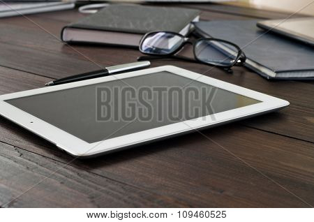 Tablet Computer On Office Wooden Table