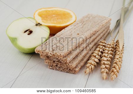 Dry Diet Crisp Breads With Ears Of Wheat And Fruit