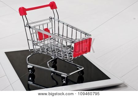 Small Trolley On Tablet Computer