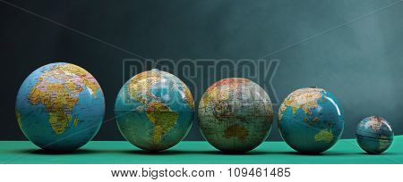 five globes lined up