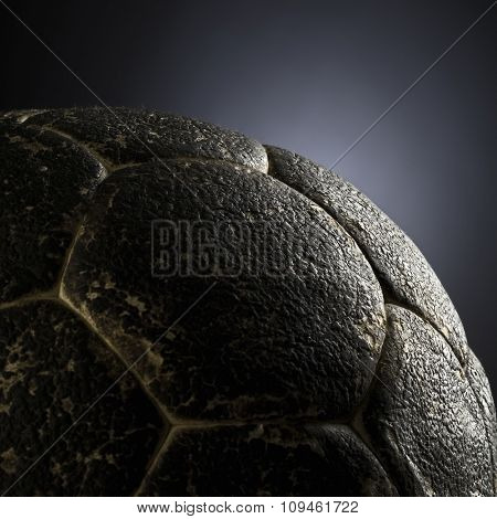 detail of an old leather soccer ball