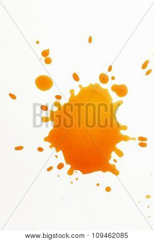 yellow spatter stain on white