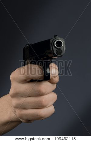 hand holding black revolver