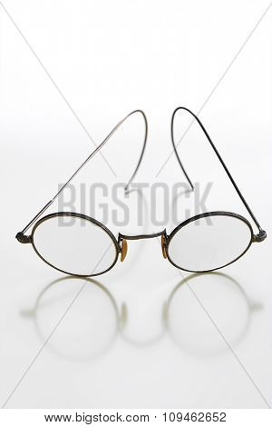old rimmed glasses on white
