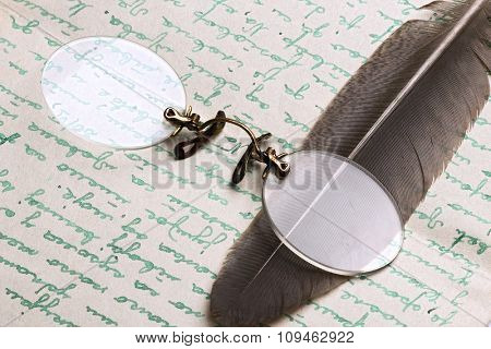 old letter, spectacles and a quill